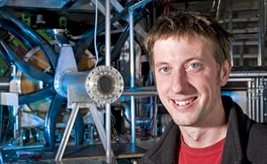 Sean Giblin, muon instrument scientist in front of the Emu muon spectrometrer at ISIS