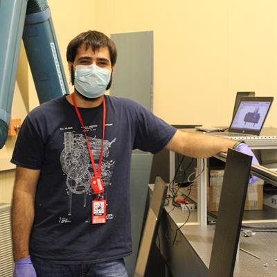 ​PhD student Marco Baruzzo and the laser set up in RIKEN Port 1