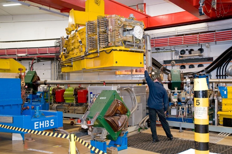 A dipole magnet being lifted into place in the ISIS synchrotron